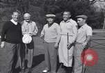 Image of Bing Crosby leads companions singing on golf course Washington DC USA, 1956, second 3 stock footage video 65675037953