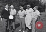 Image of Bing Crosby leads companions singing on golf course Washington DC USA, 1956, second 6 stock footage video 65675037953