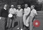Image of Bing Crosby leads companions singing on golf course Washington DC USA, 1956, second 8 stock footage video 65675037953