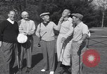 Image of Bing Crosby leads companions singing on golf course Washington DC USA, 1956, second 10 stock footage video 65675037953
