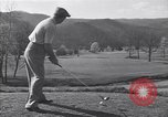 Image of Bing Crosby and Ben Hogan play golf White Sulphur Springs West Virginia USA, 1956, second 1 stock footage video 65675037954