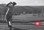 Image of Bing Crosby and Ben Hogan play golf White Sulphur Springs West Virginia USA, 1956, second 5 stock footage video 65675037954