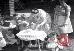 Image of first birthday of Nancy Gayle born to dwarf parents Austin Texas USA, 1950, second 1 stock footage video 65675038032
