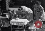 Image of first birthday of Nancy Gayle born to dwarf parents Austin Texas USA, 1950, second 5 stock footage video 65675038032