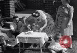 Image of first birthday of Nancy Gayle born to dwarf parents Austin Texas USA, 1950, second 7 stock footage video 65675038032