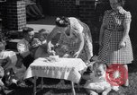 Image of first birthday of Nancy Gayle born to dwarf parents Austin Texas USA, 1950, second 9 stock footage video 65675038032