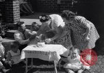 Image of first birthday of Nancy Gayle born to dwarf parents Austin Texas USA, 1950, second 12 stock footage video 65675038032