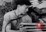 Image of Vietcong soldier action Vietnam War Vietnam, 1966, second 11 stock footage video 65675038094