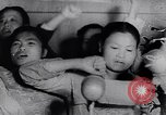 Image of North Vietnamese propaganda meeting Vietnam, 1966, second 9 stock footage video 65675038097