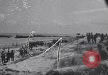 Image of Equipment and reinforcements landing in invasion of France Normandy France, 1944, second 1 stock footage video 65675038225