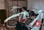 Image of Steps in production of a vinyl phonograph record Indianapolis Indiana USA, 1956, second 1 stock footage video 65675038229