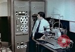 Image of Steps in production of a vinyl phonograph record Indianapolis Indiana USA, 1956, second 2 stock footage video 65675038229