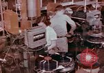 Image of production and packaging of vinyl phonograph records United States USA, 1956, second 2 stock footage video 65675038230