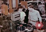 Image of production and packaging of vinyl phonograph records United States USA, 1956, second 8 stock footage video 65675038230