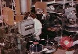 Image of production and packaging of vinyl phonograph records United States USA, 1956, second 10 stock footage video 65675038230