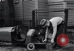 Image of Edward Floyd delivers newspapers in homemade car Seattle Washington USA, 1933, second 2 stock footage video 65675038327