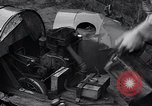 Image of Edward Floyd delivers newspapers in homemade car Seattle Washington USA, 1933, second 5 stock footage video 65675038327