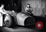 Image of Malcolm Campbell and Bluebird motorcar Brooklands England, 1931, second 5 stock footage video 65675038348