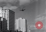 Image of auto gyro landing Miami Florida USA, 1931, second 2 stock footage video 65675038351
