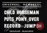 Image of Nine year old boy champion equestrian Wilmington Ohio USA, 1935, second 3 stock footage video 65675038436