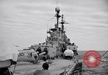 Image of American Cruiser USS Saint Paul Western Pacific Ocean, 1957, second 12 stock footage video 65675038495