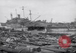 Image of damaged ships Yonabaru Japan, 1944, second 11 stock footage video 65675038642