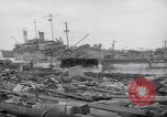 Image of damaged ships Yonabaru Japan, 1944, second 12 stock footage video 65675038642