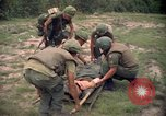 Image of Operation Wahiawa wounded with Bell UH-1B Iroquois Huey helicopter Cuchi South Vietnam, 1966, second 7 stock footage video 65675038728