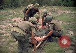 Image of Operation Wahiawa wounded with Bell UH-1B Iroquois Huey helicopter Cuchi South Vietnam, 1966, second 8 stock footage video 65675038728