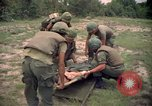 Image of Operation Wahiawa wounded with Bell UH-1B Iroquois Huey helicopter Cuchi South Vietnam, 1966, second 11 stock footage video 65675038728