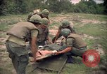 Image of Operation Wahiawa wounded with Bell UH-1B Iroquois Huey helicopter Cuchi South Vietnam, 1966, second 12 stock footage video 65675038728