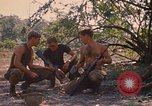 Image of 101st Airborne Division in Cambodia Se San  Cambodia, 1970, second 11 stock footage video 65675038729