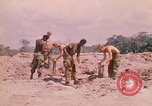 Image of 101st Airborne Division soldiers build bunkers Parrots Beak Cambodia, 1970, second 6 stock footage video 65675038731