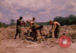 Image of 101st Airborne Division soldiers build bunkers Parrots Beak Cambodia, 1970, second 7 stock footage video 65675038731