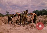 Image of 101st Airborne Division soldiers build bunkers Parrots Beak Cambodia, 1970, second 8 stock footage video 65675038731