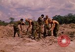 Image of 101st Airborne Division soldiers build bunkers Parrots Beak Cambodia, 1970, second 9 stock footage video 65675038731