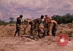 Image of 101st Airborne Division soldiers build bunkers Parrots Beak Cambodia, 1970, second 11 stock footage video 65675038731