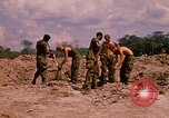 Image of 101st Airborne Division soldiers build bunkers Parrots Beak Cambodia, 1970, second 12 stock footage video 65675038731