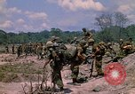 Image of 101st Airborne Division soldiers board helicopter Parrots Beak Cambodia, 1970, second 4 stock footage video 65675038733