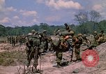 Image of 101st Airborne Division soldiers board helicopter Parrots Beak Cambodia, 1970, second 5 stock footage video 65675038733