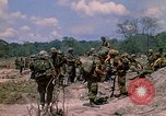 Image of 101st Airborne Division soldiers board helicopter Parrots Beak Cambodia, 1970, second 6 stock footage video 65675038733