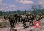 Image of 101st Airborne Division soldiers board helicopter Parrots Beak Cambodia, 1970, second 7 stock footage video 65675038733