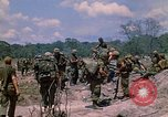 Image of 101st Airborne Division soldiers board helicopter Parrots Beak Cambodia, 1970, second 8 stock footage video 65675038733