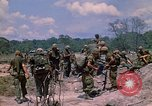 Image of 101st Airborne Division soldiers board helicopter Parrots Beak Cambodia, 1970, second 9 stock footage video 65675038733