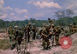 Image of 101st Airborne Division soldiers board helicopter Parrots Beak Cambodia, 1970, second 10 stock footage video 65675038733