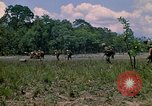 Image of 101st Airborne Division soldiers board helicopter Parrots Beak Cambodia, 1970, second 11 stock footage video 65675038733