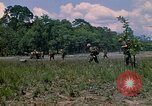 Image of 101st Airborne Division soldiers board helicopter Parrots Beak Cambodia, 1970, second 12 stock footage video 65675038733