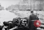 Image of German Infantry operating in marshes in Winter Ukraine, 1944, second 2 stock footage video 65675038829