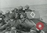 Image of US troops make amphibious assault at Omaha Beach on D-Day Normandy France, 1944, second 1 stock footage video 65675038892