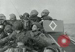 Image of US troops make amphibious assault at Omaha Beach on D-Day Normandy France, 1944, second 4 stock footage video 65675038892